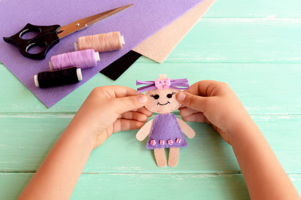 kid's hands holding sewing craft
