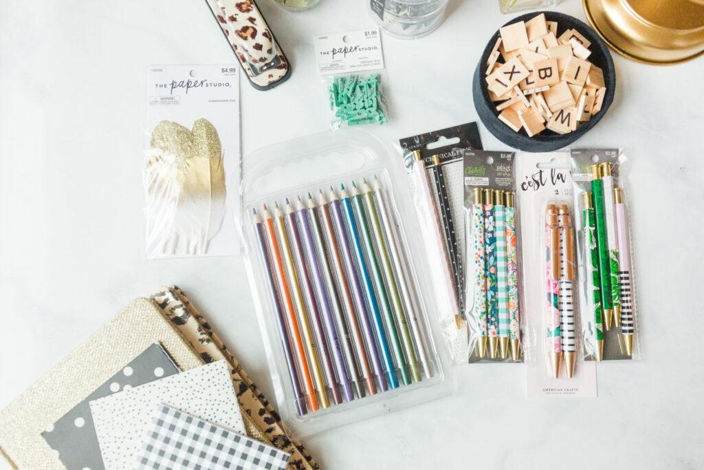 Homeschool school supplies scattered on table top