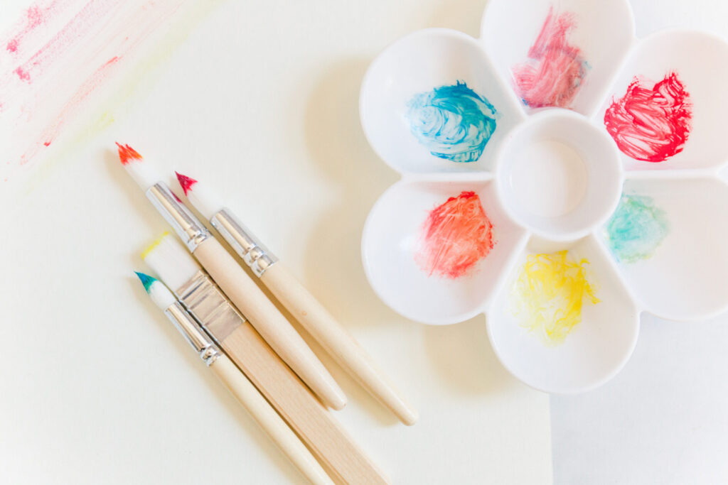 paint brushes with paint and paint tray