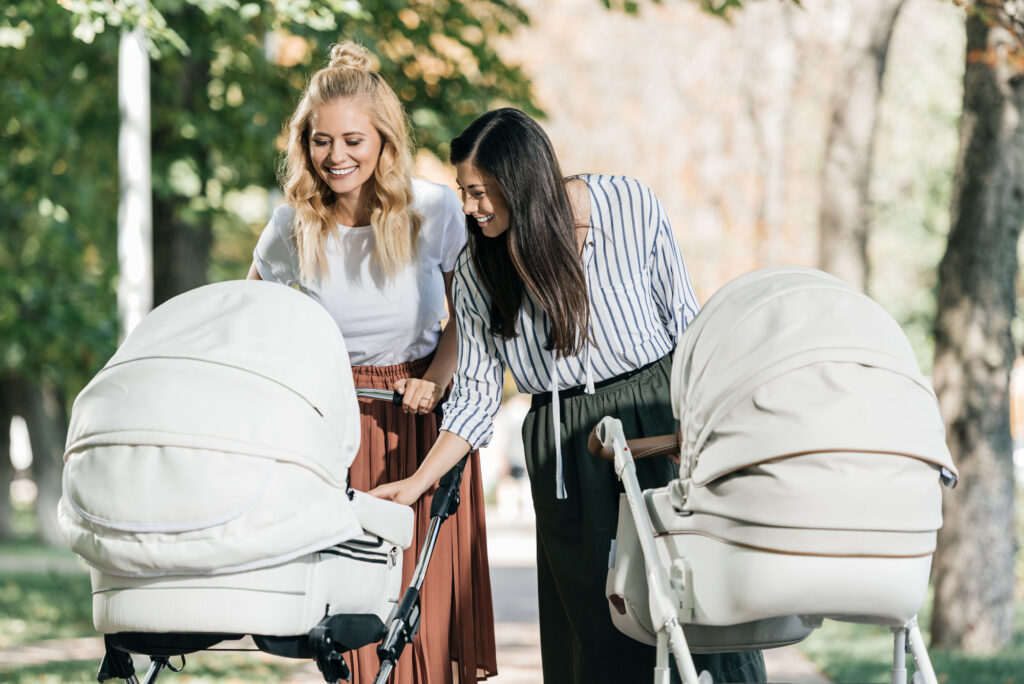two homeschool moms with strollers