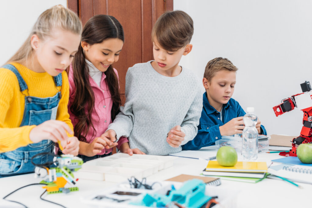 kids doing a stem project together at homeschool group
