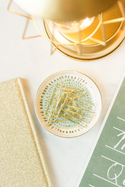 alphabet picture, tabletop lamp, gold book