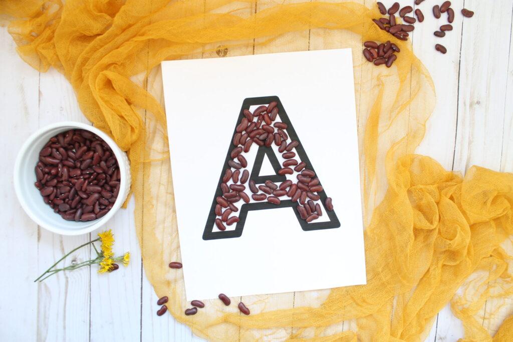 Letter practice charlotte mason style using beans